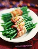 Bundles of green beans tied with strips of bacon