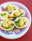 Petoncle scallops with young vegetables