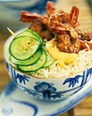 Bowl of rice with shrimps, soya sauce and sesame seeds