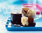 Cup of coffee and a dish of ice cream with Speculos biscuits