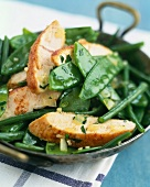 Pan-fried chicken with green vegetables
