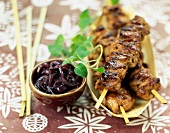 Satay-style pork kebabs grilled on the barbecue