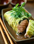 Steam-cooked salmon wrapped in chinese cabbage
