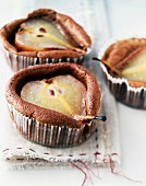 Moist chocolate and pear tarts