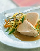 Pike quenelle with thinly sliced vegetables