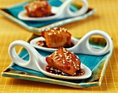 Caramelized chicken and sesame seed appetizers