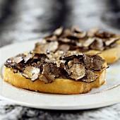 Thinly sliced truffles and Fleur de sel sea salt on a slice of bread