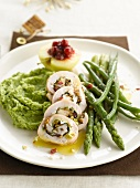 Turkey roulade, mushy peas and green asparagus
