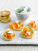 Mini blinis with smoked salmon and parmesan flakes