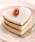 Heart-shaped sponge cake with rose-flavored jam