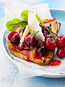 Stewed cherries,cheese and mesclun on toast