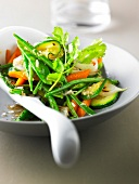 Warm vegetable salad cooked in a wok