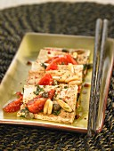 Tofu with basil, tomatoes, capers and pine nuts