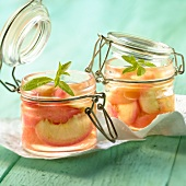Steam-cooked peaches in verbana syrup