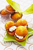 Small cakes filled with cherry jam and whipped cream