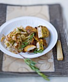 Sliced chicken breast coated with breadcrumbs and chicory