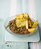 Hamburger coated with breadcrumbs and green pepper, sauteed potatoes