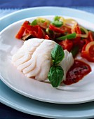 Cod with red and green peppers
