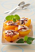 Poached peaches with cream and maple syrup