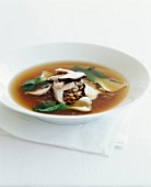 Wheat broth with pak-choi cabbage and mushrooms