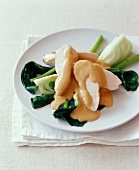 Turkey breast with mustard sauce and pak-choi cabbage
