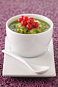 Kiwi and Muscat soup with redcurrants