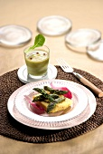 Cream of asparagus and green asparagus tops with scrambled eggs