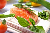 Raw salmon with vegetables and herbs