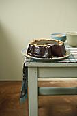 Chocolate cake coated with dark chocolate