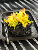 Squid ink spaghettis nest filled with gambas curry