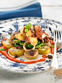 Octopus with potatoes, young turnips and red pepper puree