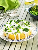 Soya and corn cake coated with cream and green vegetables