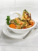 Rice with artichokes, peppers and carrots