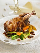 Roast partridge with plum sauce and vegetables