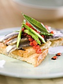 Marinated salmon, strawberry and wild asparagus on sliced bread