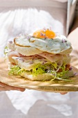 York ham, fried egg and edible flower sandwich