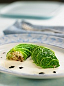 Cabbage leaves stuffed with squid, leeks and onions
