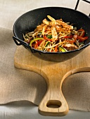 Sliced chicken,peppers and beansprouts sauteed in a wok