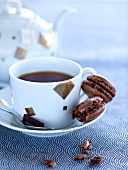 Cup of coffee and chocolate macaroons