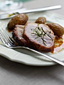 Roast pork with rosemary and roast potatoes
