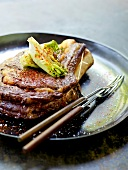 Baked beef chop with lettuce hearts