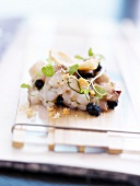 Bass Tartare with blackcurrants and a parmesan savoury shortbread cookie