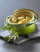 Casserole dish of monkfish with curry,coconut milk and coriander