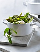 Casserole dish of spring vegetables with mint