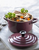 Casserole dish of Petit salé with lentils