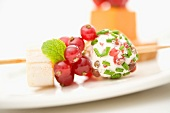 Cheese and red fruit brochette