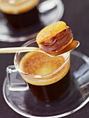 Dried apricot with chocolate filling and a cup of coffee