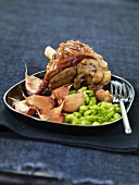 Leg of lamb with broad beans and garlic