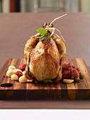 Stuffed poulard hen à la toulousaine