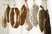 Variety of dried sausages hanging